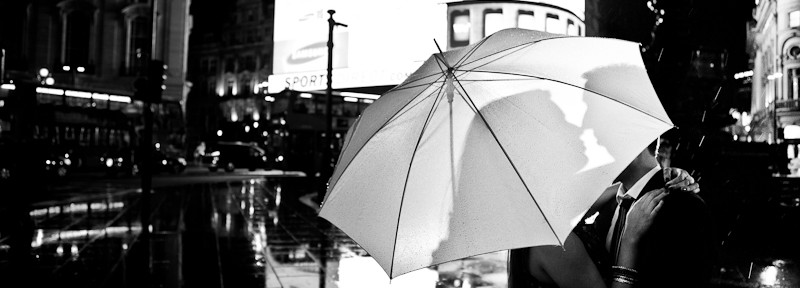 Silhouette behind an umbrella in Centra London