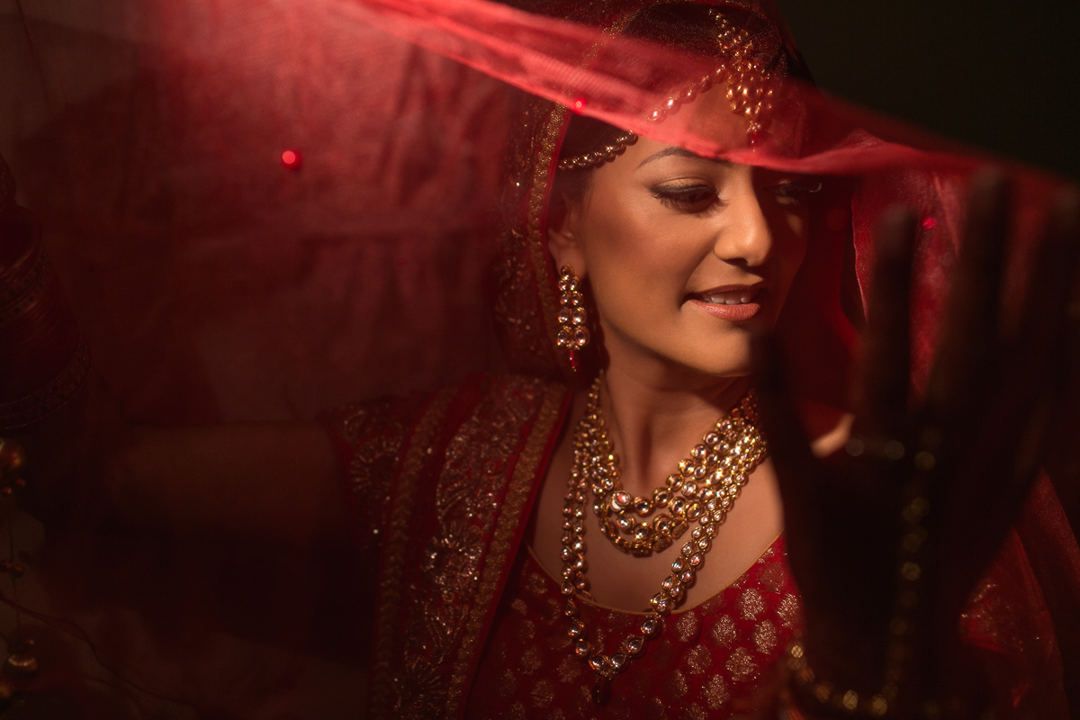 Indian Wedding Photography, Indian bride Shilpa Darbar in red veil