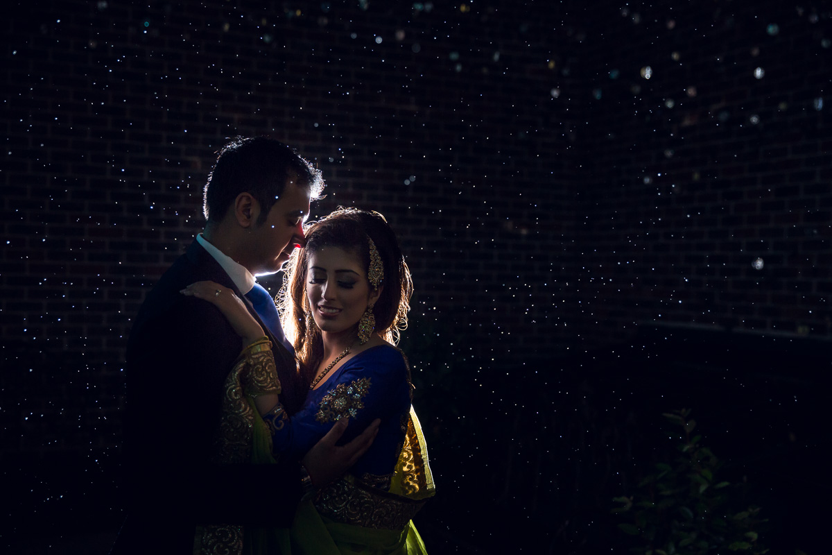 Indian Wedding Photography - couple close to each other with the rain drops