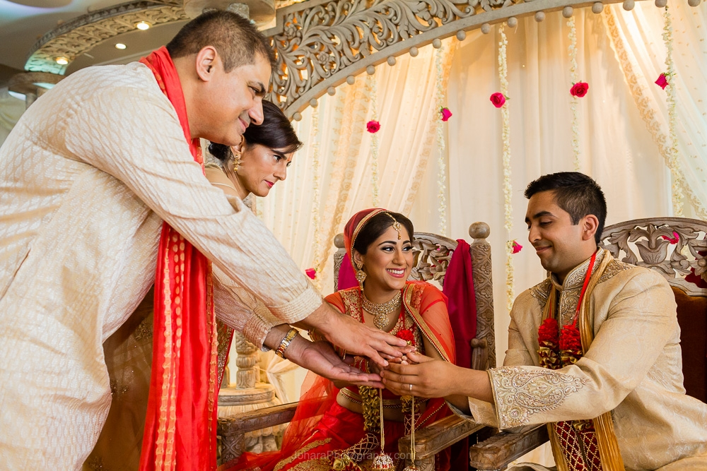 Hindu wedding ceremony, brides parents give their daughters hand in marriage