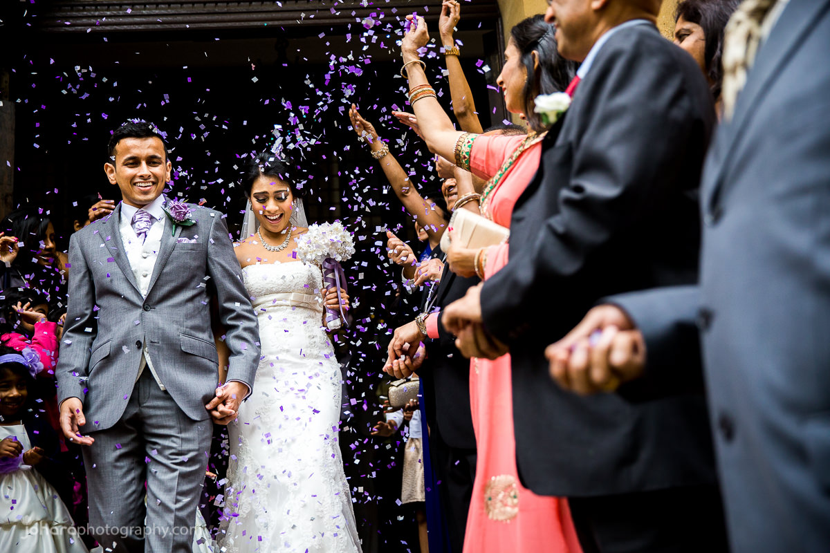 Couple leave the Ealing Town Hall after their civil wedding with confetti thrown over them